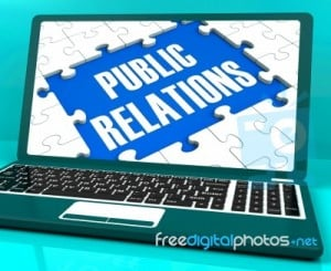 public-relations-on-laptop-shows-online-press-100128892